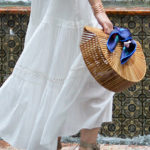 Flowing white dress at a garden party
