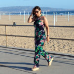 Windblown on the beach in a floral jumpsuit for summer