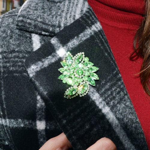 Vintage brooch and plaid coat